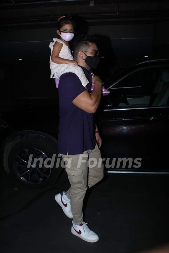 Neha Dhupia and Angad Bedi snapped arriving at Mumbai airport on Monday