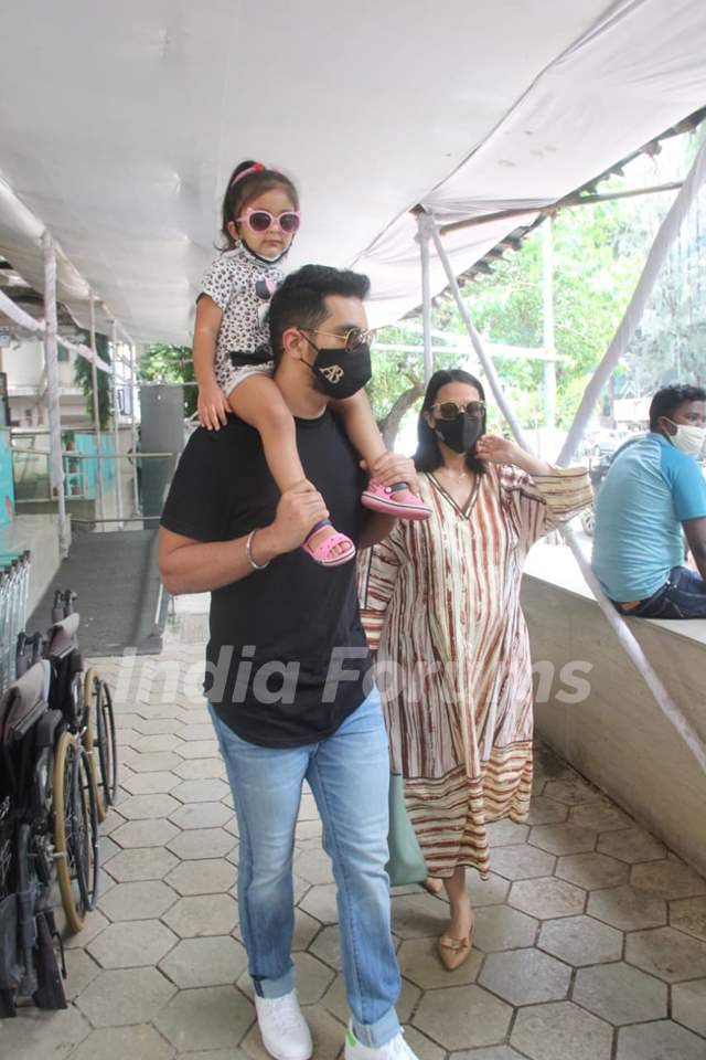 Neha Dhupia snapped with husband Angad Bedi and their daughter
