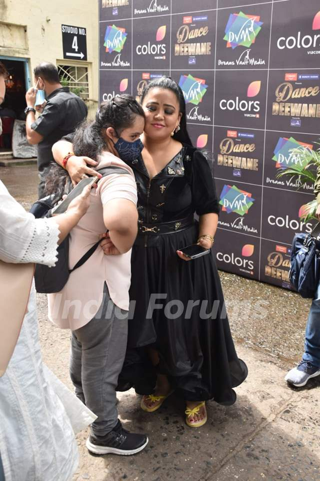 Bharti Singh hugs a fan on the sets of Dance Deewane